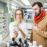 Pharmacist with client in the pharmacy store