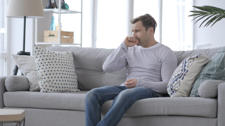 Coughing Sick Adult Man Sitting on Couch, Cough