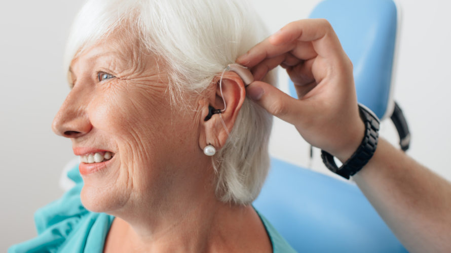 adjusting of a hearing aid for an aged woman