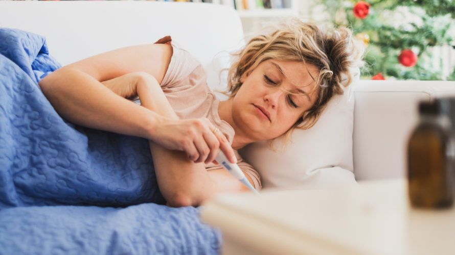 Young woman feeling sick after seasonal influenza