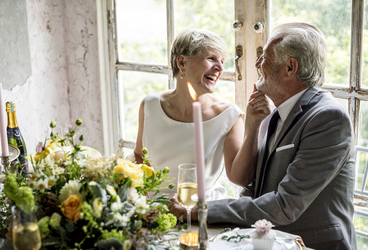 Senior couple sitting laughing together
