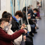 Chinese people wearing surgical mask sitting in subway