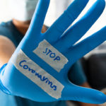 The glove-wearer has a message to stop the Coronavirus